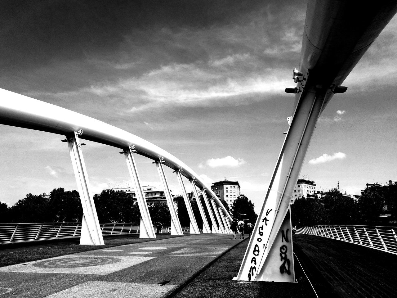 transportation, sky, day, real people, cloud - sky, built structure, one person, bridge - man made structure, architecture, outdoors, tree, people