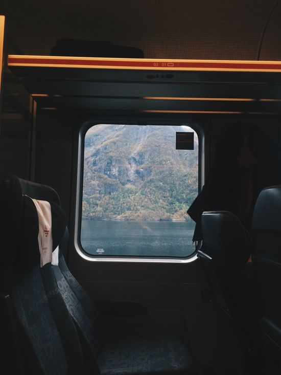 Comfortable Glass - Material Mountains Photography Themes Railway Side View Sitting Train Transparent Travel Traveling Water Window