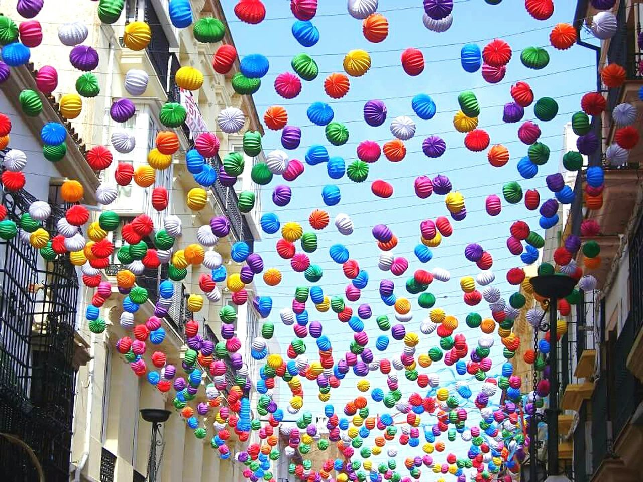 Multi Colored Architecture Low Angle View Hanging Built Structure Lantern Building Exterior Variation Colorful Large Group Of Objects In A Row Outdoors Sky Day No People Decoration Place Of Worship Cloud - Sky High Section Tourism Andalucia, Spain Andalucía Ronda Spain