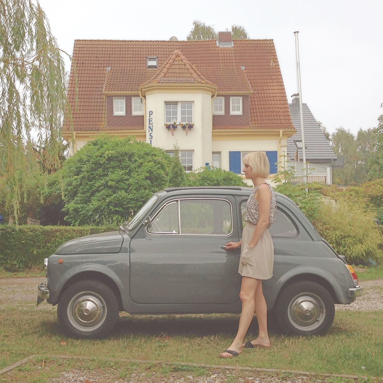 Architecture Blond Hair Building Exterior Car Child Childhood Fiat Fiat 500 Full Length Girl Girl Car House Girl Power Grass Grey Car House Italian Car Mature Adult Mature Women One Person Outdoors People Side View Small Car Standing Woman