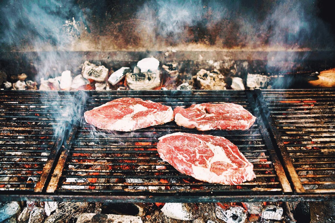 Barbecue Preparation  Smoke - Physical Structure Barbecue Grill Meat Barbecue Heat - Temperature Food Food And Drink Freshness Outdoors Grilled Healthy Eating Burning No People Day Red Meat Dinner Freshness Cooking Chef Carnivore Beefsteak Beef Delicious Cooking At Home