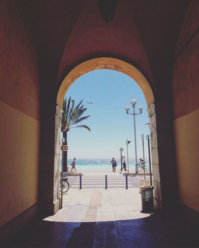 Arch Architecture Day Built Structure Sea Men Travel Tourism Blue City Water Outdoors Sky People France Beach Coast Real People