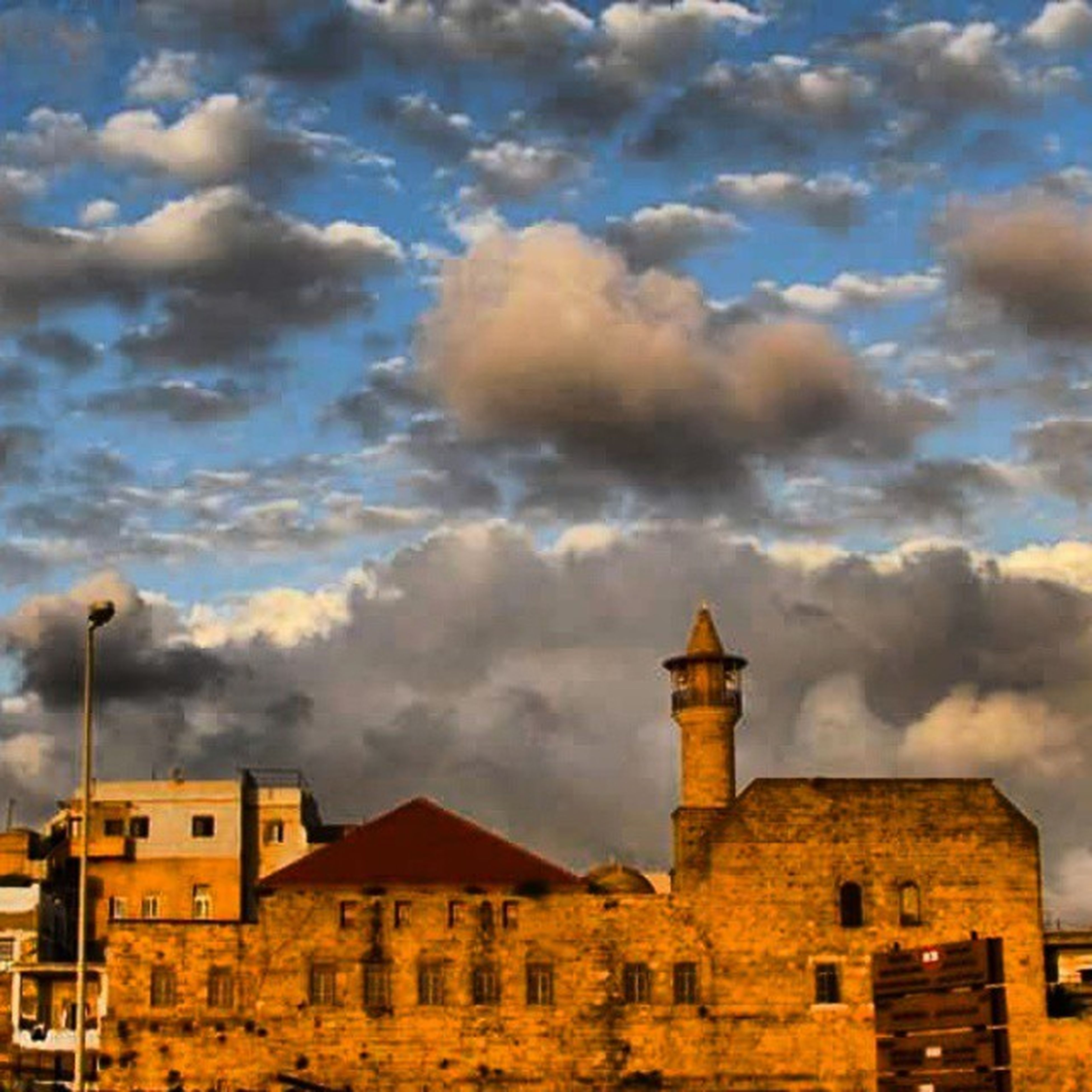 building exterior, architecture, built structure, sky, cloud - sky, cloudy, house, residential structure, residential building, weather, cloud, low angle view, building, overcast, outdoors, city, no people, nature, storm cloud, sunset