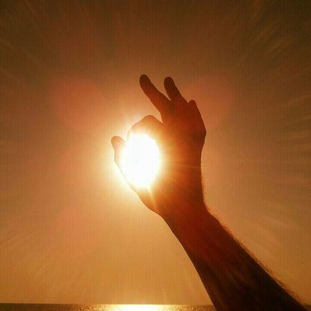 Sun hole Sun Hole Hand Silhouette