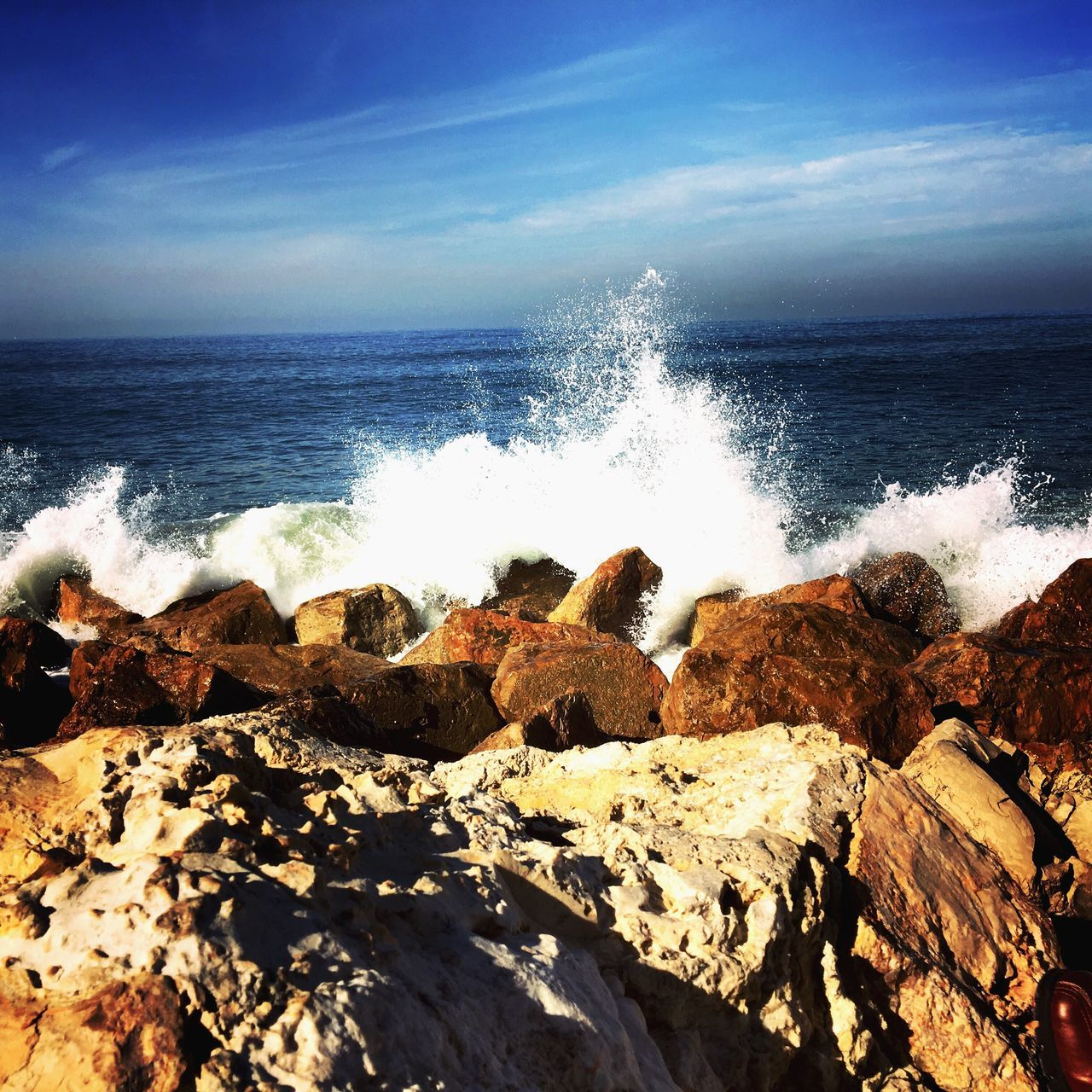 sea, water, horizon over water, wave, nature, beauty in nature, rock - object, motion, power in nature, rock, beach, scenics, rough, day, outdoors, no people, sky, tranquil scene, tranquility, breaking, crash, force, sunlight, hitting