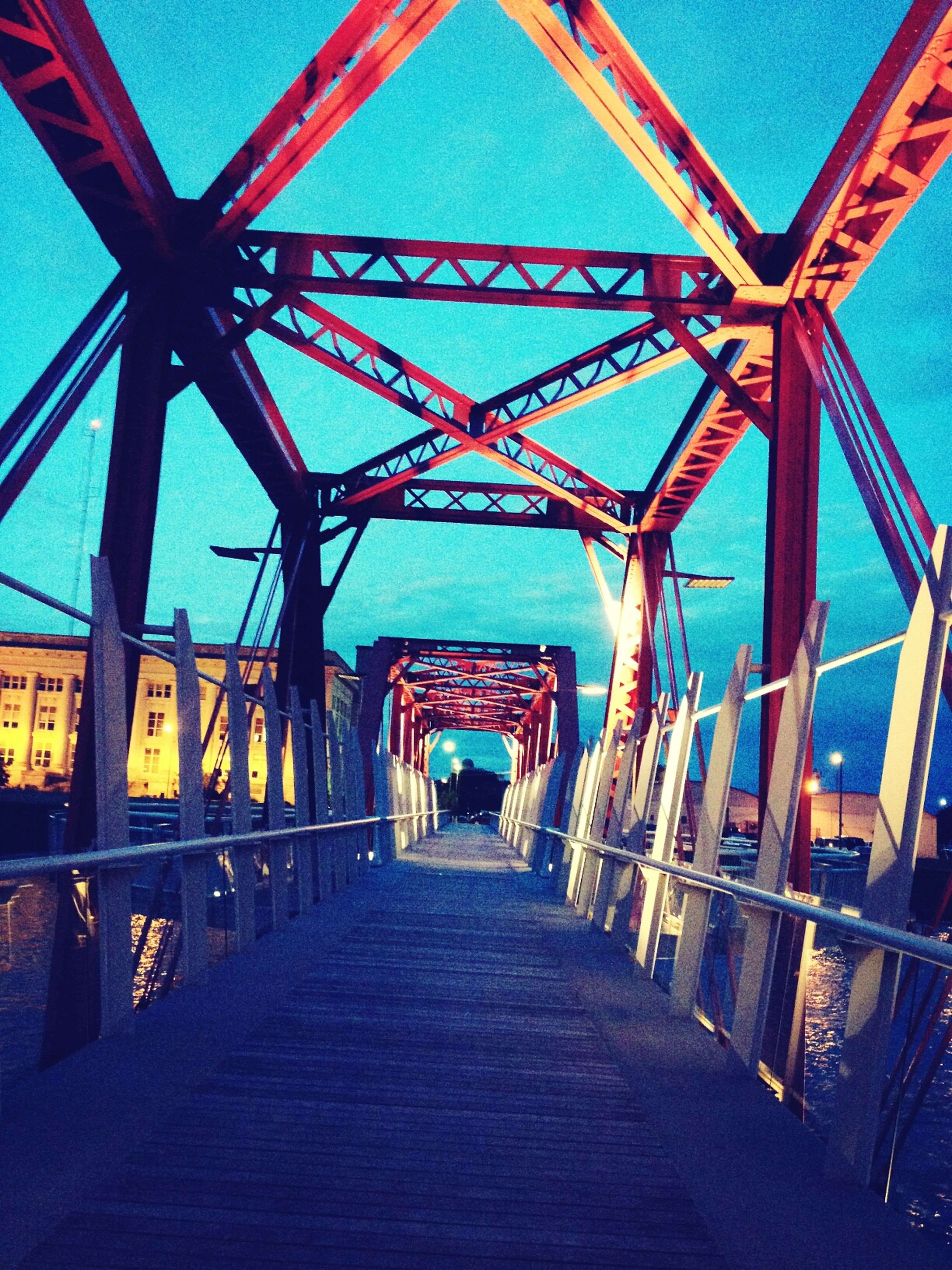 architecture, built structure, the way forward, diminishing perspective, transportation, bridge - man made structure, connection, vanishing point, building exterior, railing, incidental people, outdoors, sky, no people, day, long, empty, engineering, in a row, bridge
