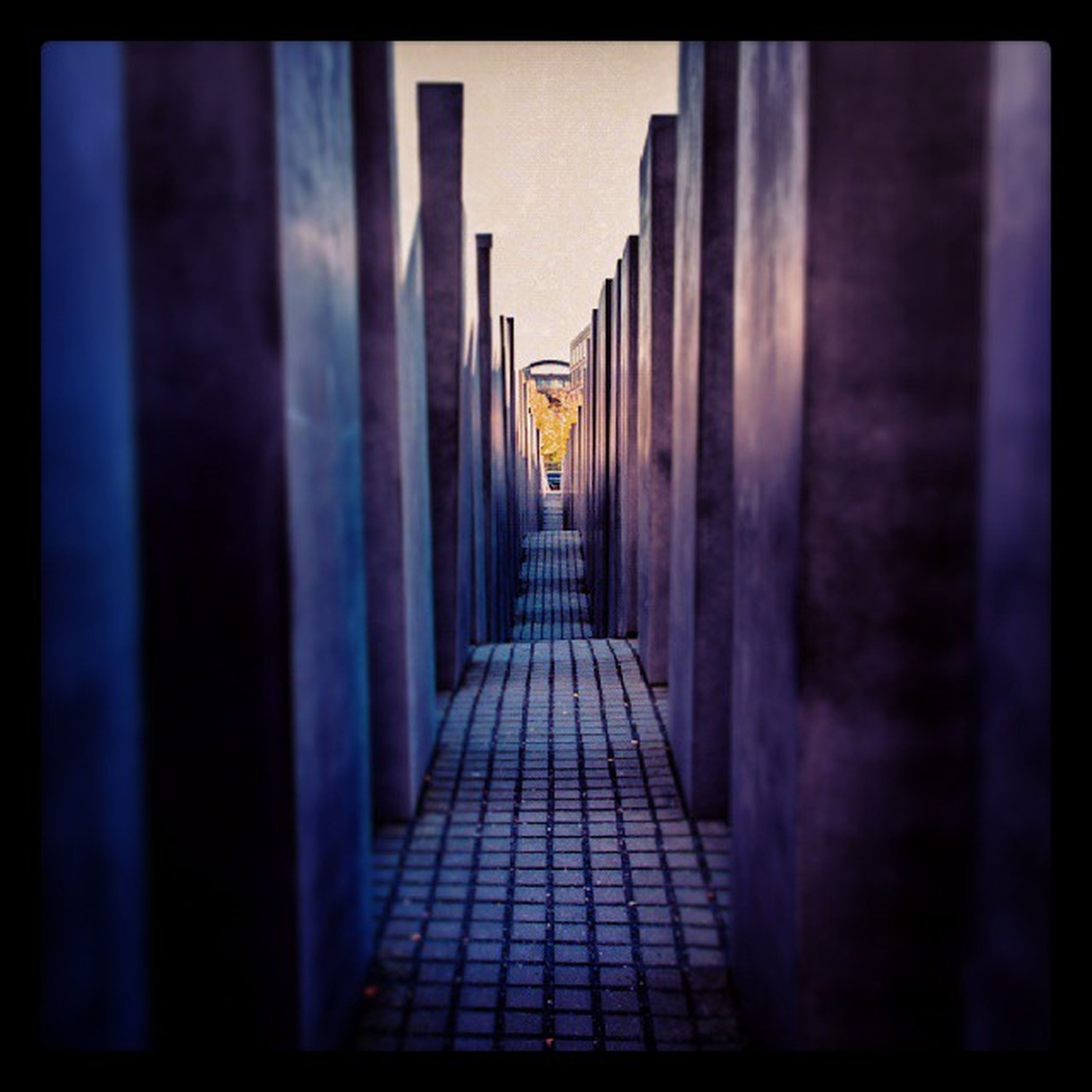 architecture, built structure, the way forward, transfer print, building exterior, diminishing perspective, auto post production filter, narrow, vanishing point, corridor, in a row, walkway, sky, building, cobblestone, long, day, architectural column, city, sunlight