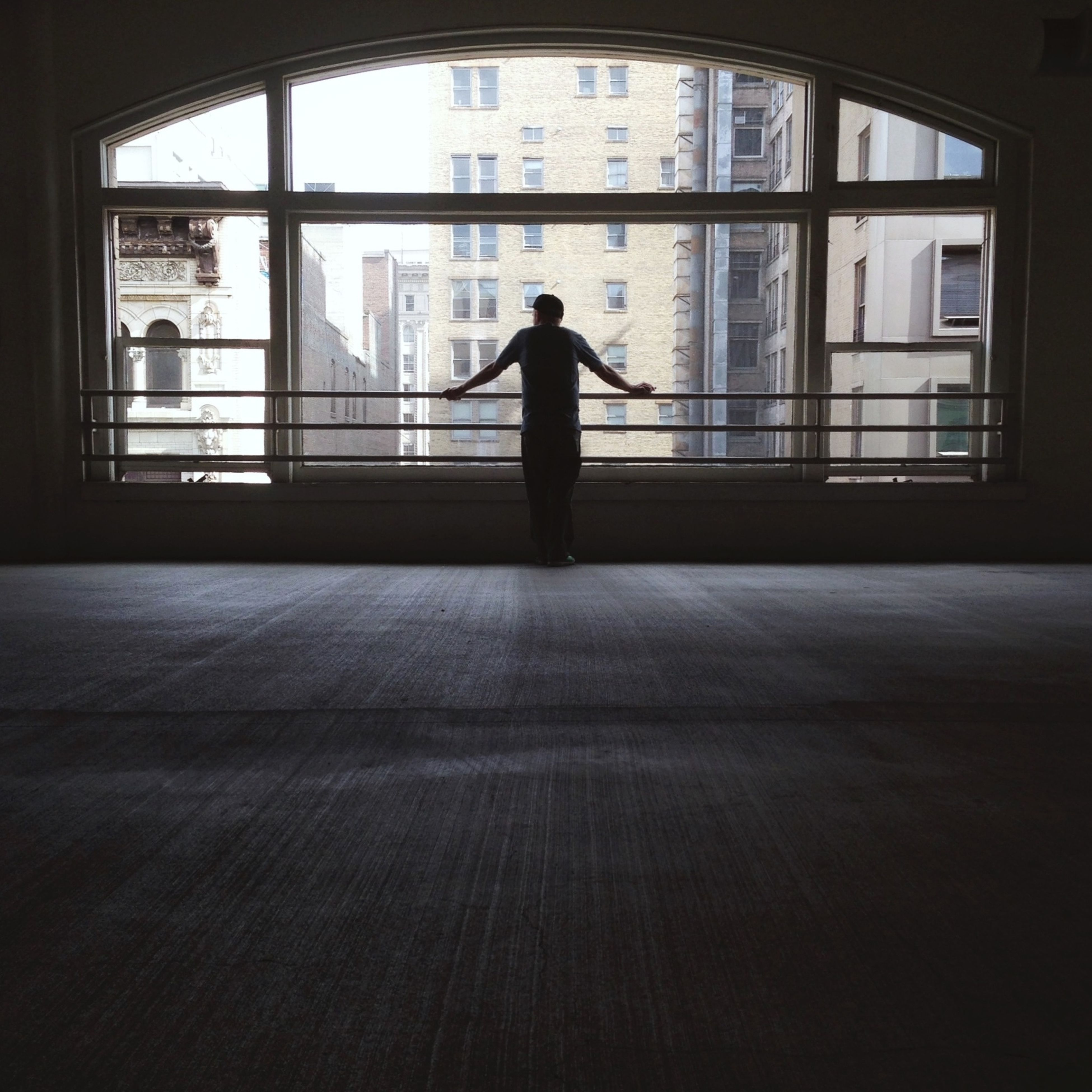 indoors, silhouette, architecture, built structure, full length, window, men, rear view, lifestyles, standing, walking, person, glass - material, leisure activity, unrecognizable person, side view, one man only, building