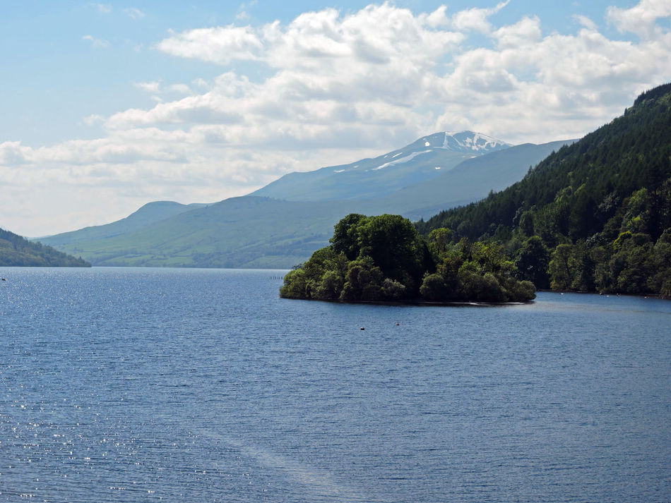 Early Summer afternoon on Loch Tay , Scotland . Still a little snow remaining on the mountain in the background. June 2014. Scottish Highlands Summer Spring Scottish Landscape Scottish Lochs Loch  Lake Water And Sun Daylight Summer Snow Mountain