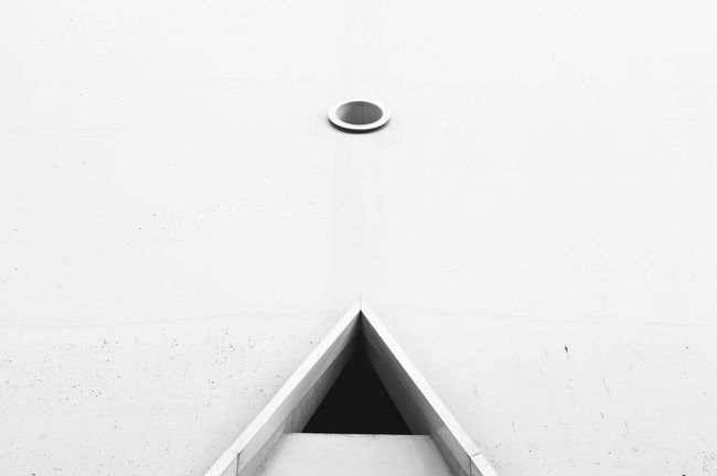 Cyclops Shapes Architecture Built Structure Classic Cyclop Day Facade Detail Full Circle Grain Effect Horizontal Minimalistic Modern Architecture Monochrome Photography No People Simple Sparse Triangle Shape White Color Windows