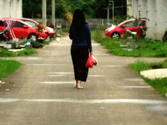 One Woman Only One Person Car Only Women On The Move Rear View Rain Red Street Transportation Walking Wet Full Length Adults Only City Land Vehicle Outdoors City Life Mode Of Transport Building Exterior