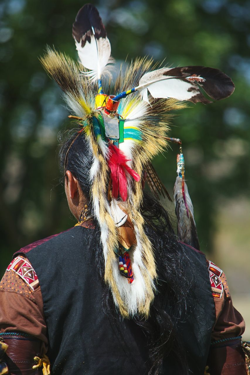 Rear View Of Man Wearing Tribal Headwear