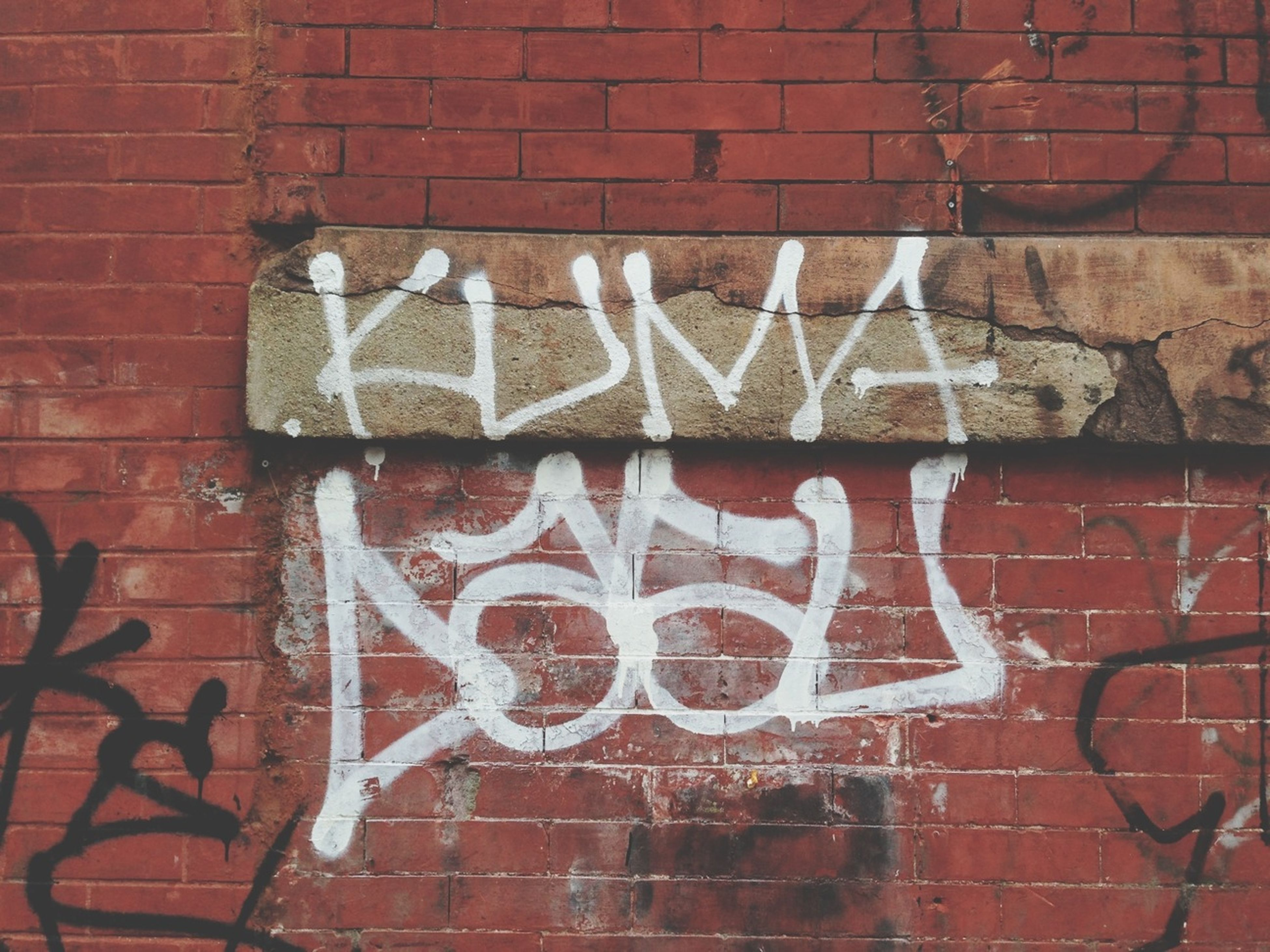 brick wall, text, red, communication, wall - building feature, western script, architecture, built structure, wall, building exterior, capital letter, graffiti, close-up, brick, no people, day, outdoors, sign, pattern, textured