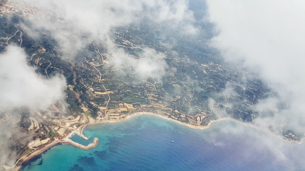 View From The Window... Aerial Shot Landing Stage Travel Destinations Aerial View Cityscape Coastline Looking Down Cloud - Sky Outdoors Scenics Beauty In Nature How Do We Build The World? Above The Clouds Above The City Landscape See What I See Cloudscape - Greek Islands Flying High