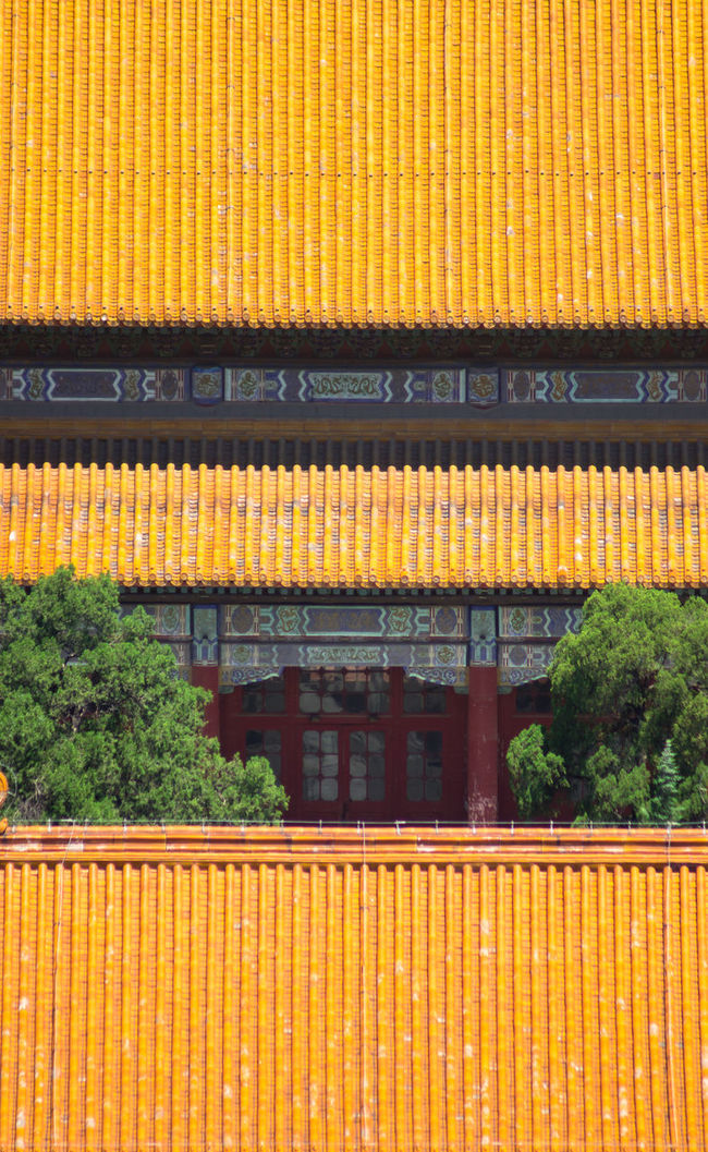 A visual study of symmetry and the important of colours in Chinese architecture. Being symbolic of prosperity and good fortune, yellow is a popular colour used on traditional Chinese roofs. Ancient Architecture Beijing Built Structure China Heritage Orange Color Patterns Prosperity Repetition Road The Architect - 20I6 EyeEm Awards Tiles Traditional Yellow