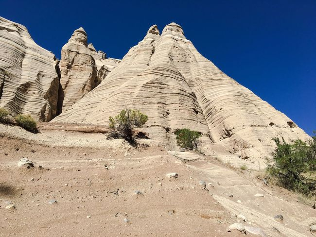 Low Angle View Clear Sky Blue Tranquil Scene Rock Formation Physical Geography Geology Tranquility Scenics Eroded Nature Solitude Outdoors Sunny Beauty In Nature Tourism Remote Arid Climate Day Sky Kasha-Katuwe Tent Rocks National Monument USAtrip USA Nature Travel Destinations