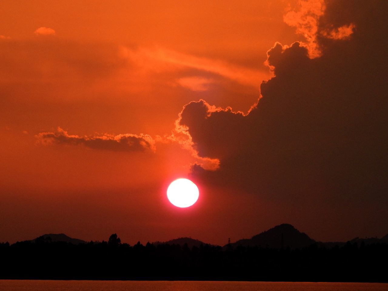 Sunset Scenics Beauty In Nature Nature Orange Color Tranquility Sky Tranquil Scene Sun Moon Outdoors Silhouette No People Idyllic Dramatic Sky Landscape Mountain Astronomy