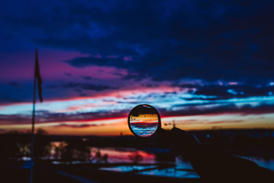 Zoom Beauty In Nature City Close-up Cloud - Sky Day Evening Human Body Part Human Hand Loupe Nature One Person Outdoors People Photography Themes Real People Reflection Scenics Silhouette Sky Sky And Clouds Sunset