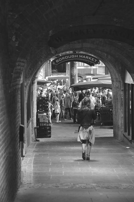 Borough Market EyeEm LOST IN London Arch Architecture Black And White Blackandwhite Built Structure City Indoors  Large Group Of People Leisure Activity Lifestyles People Real People Streetphoto_bw Stretphotography Walking Women