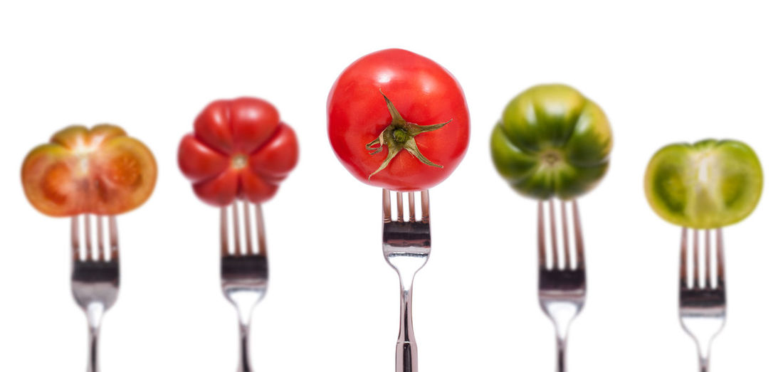 Different tomatoes on a fork Fork Green Red Close-up Day Food Food And Drink Fork Freshness Healthy Eating Indoors  No People Plate Ready-to-eat Red Still Life Tomato Vegetable White Background White Isolated