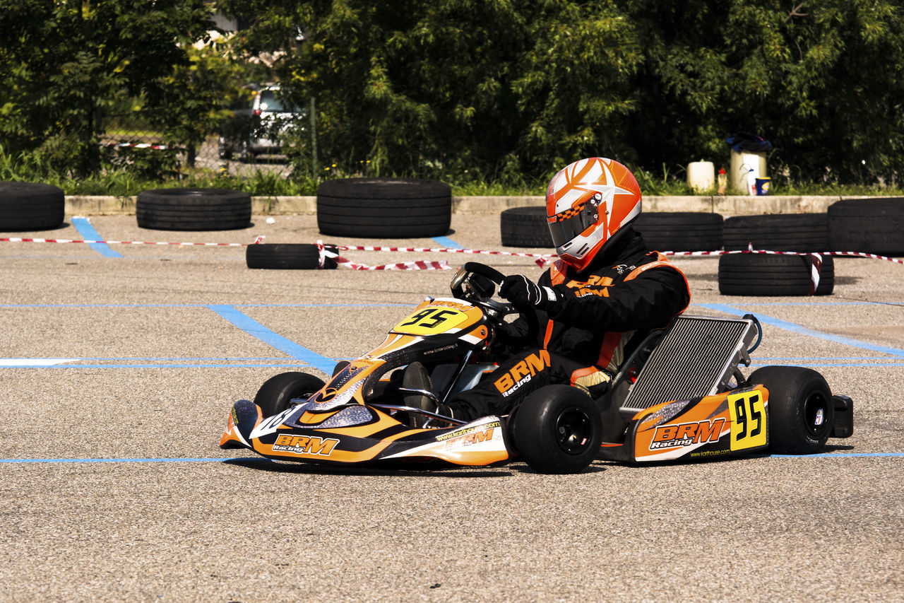 portrait of a go kart at a public event held in a parking lot Auto Racing Competition Crash Helmet Day Driving Finish Line  Formula One Racing Motor Racing Track Motorcycle Racing Motorsport Outdoors People Racecar Rivalry Speed Sport Sports Race Sports Track Two People Young Adult