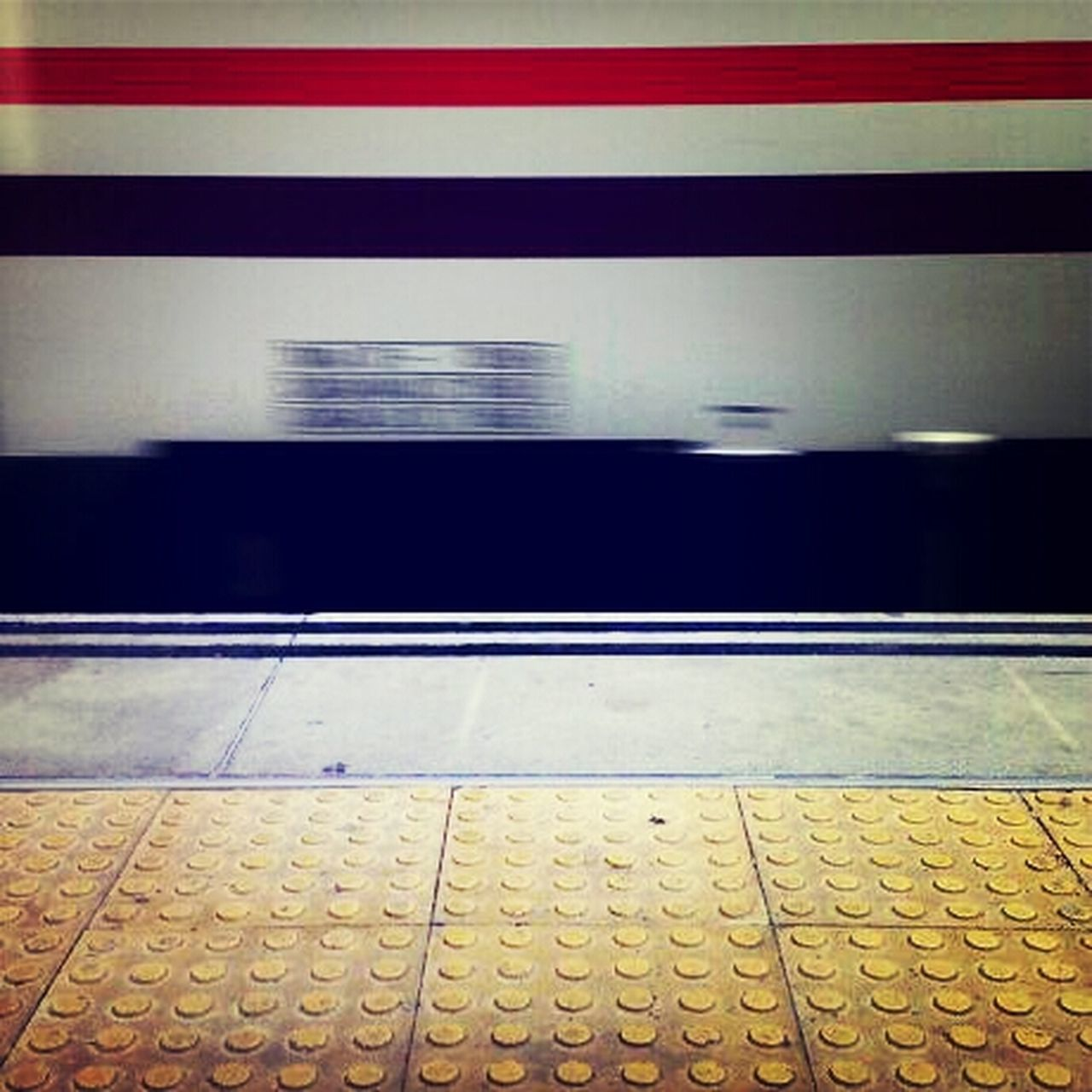 railroad station platform, transportation, railroad station, indoors, rail transportation, illuminated, no people, public transportation, yellow, day