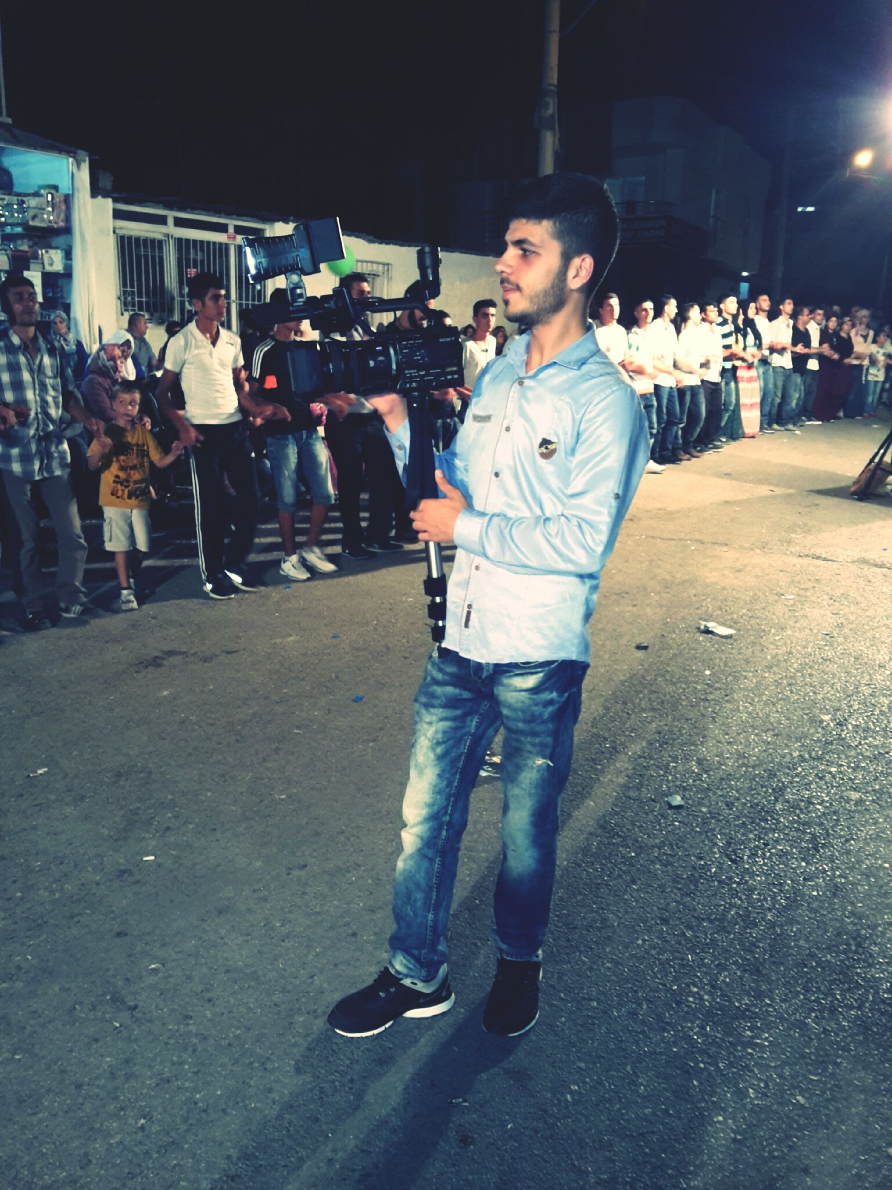 casual clothing, lifestyles, full length, night, leisure activity, street, person, standing, looking at camera, front view, portrait, childhood, elementary age, happiness, boys, road, smiling, outdoors