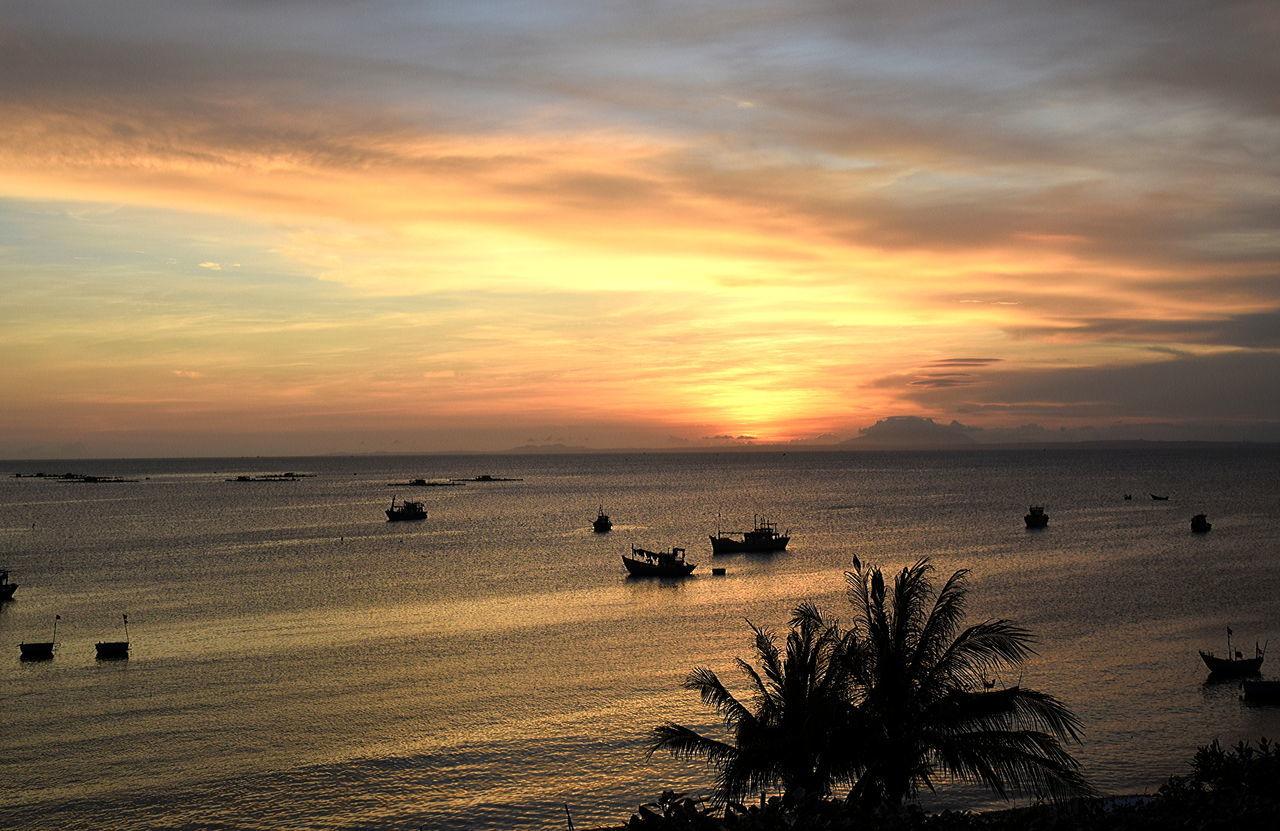 Silence and calm waters at Mui Ne, Vietnam Beach Beauty In Nature Burning Skies Cloud - Sky Horizon Over Water Nature Outdoors Sand Scenics Sea Sky Sundown Sunset Tranquility Travel Destinations Vacations Vietnam Trip Water