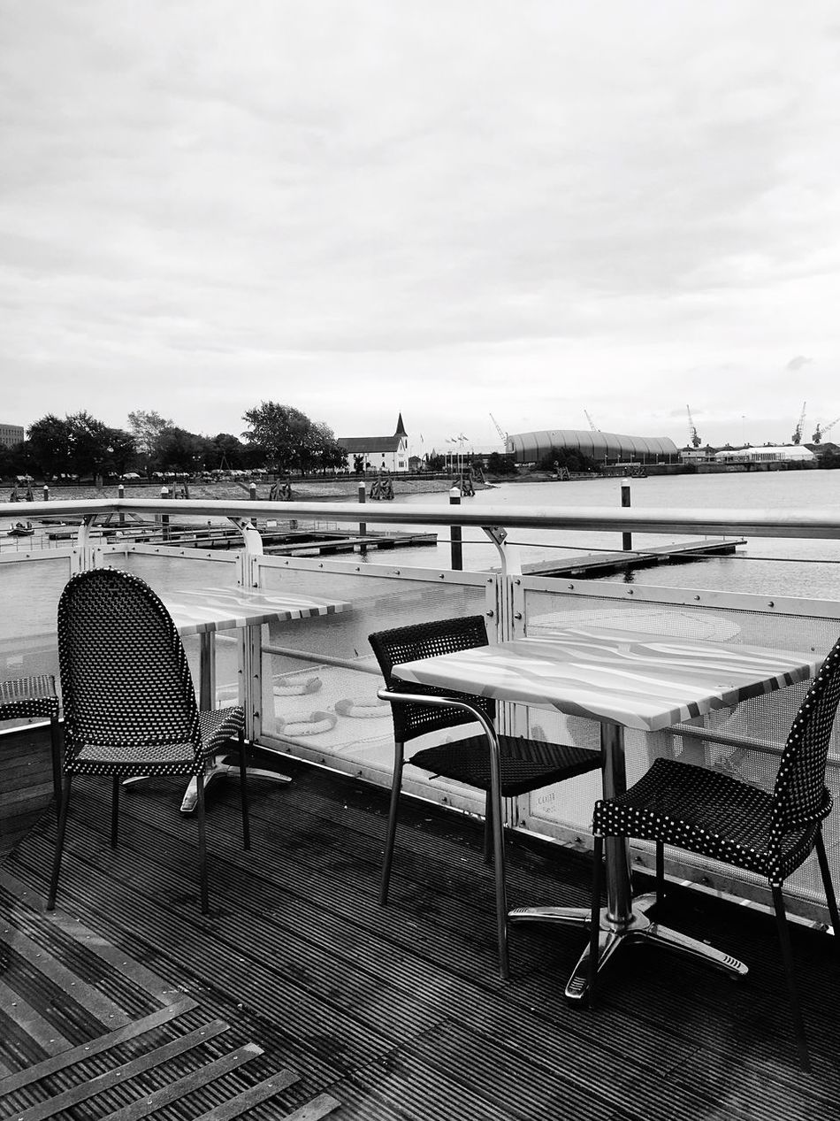 Chair Empty Absence Sky Table Cloud Group Of Objects Outdoors Tourism No People Cloud - Sky Large Group Of Objects Arrangement Waterfront Tranquil Scene Monochrome Photography Cardiff Bay Norweigian Church