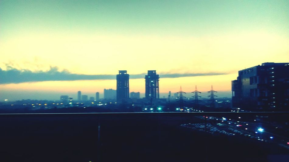 City Architecture Skyscraper Urban Skyline Sunset Cloud - Sky Building Exterior Modern Sky Cityscape Downtown District Road Business Finance And Industry Built Structure No People Outdoors Illuminated Fog Night Adapted To The City Adapted To The City Adapted To The City