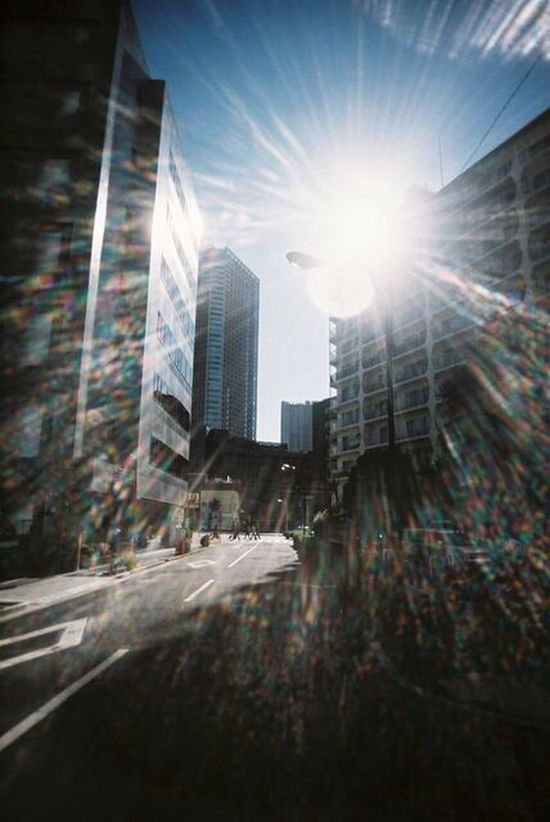 City Skyscraper Architecture Building Exterior Modern Built Structure City Life Airship Urban Skyline Toycamera Shiny Spring Walking Around Marunouchi Tokyo Film Filmisnotdead Film Photography EyeEmNewHere Snap Snapshot Snapshots Of Life Sunlight Shiny Day The Architect - 2017 EyeEm Awards