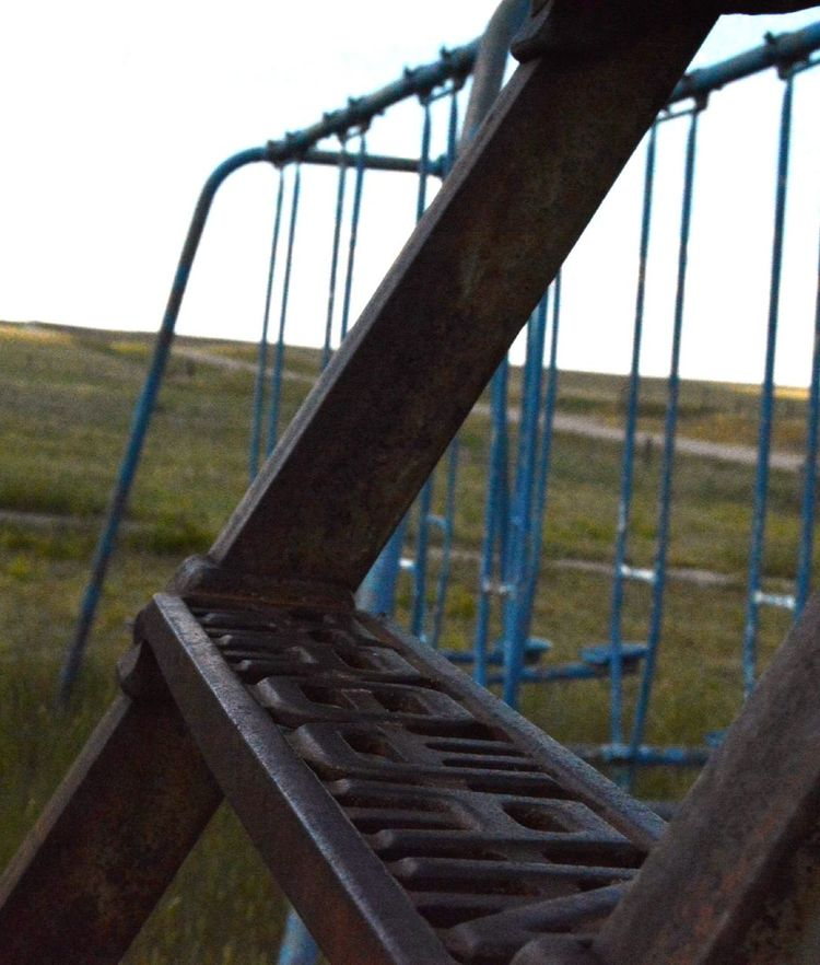 Close-up Focus On Foreground Foreground Ladder For Slide No People Old Swing Set Out In The Country Prairie Center Wyoming Rural Photography