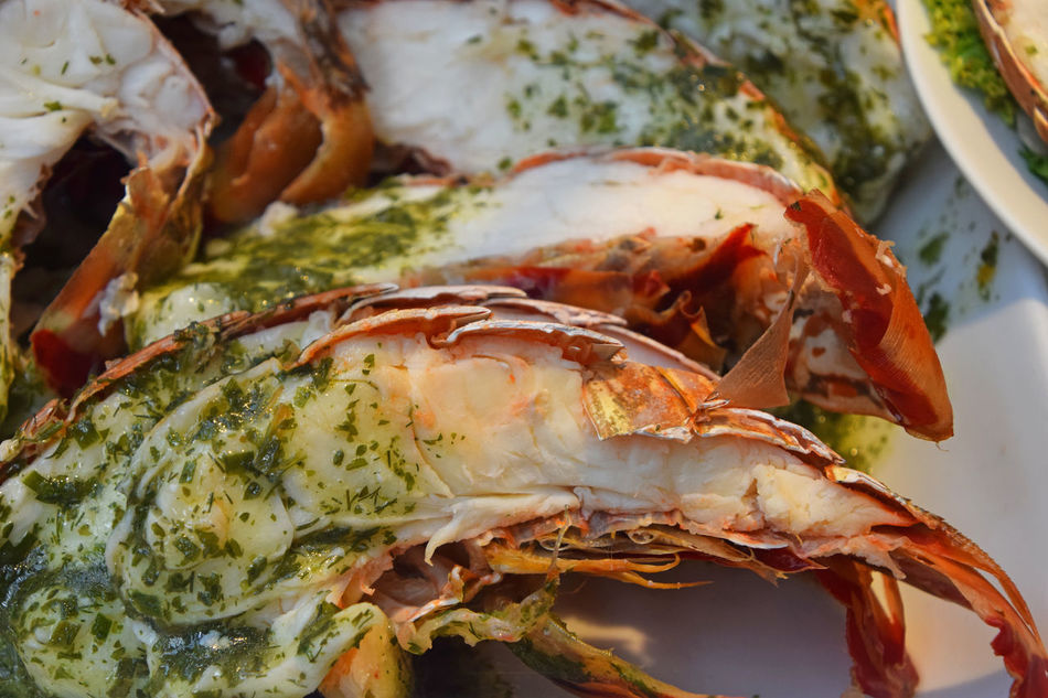 Halves of cut lobster with herbal butter dressing topping Close-up Crustacean Cuisine Fish Market Food Food And Drink Freshness Gourmet Healthy Eating High Angle View Meal No People Omar  Ready-to-eat Retail  Retail Display Seafood Store The Shop Around The Corner