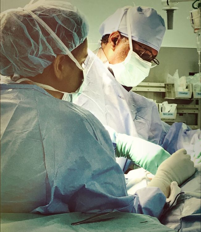 Surgeon And Scrub Nurse Assisting Surgery Scrubn Nurse Theatre Life Surgical Operation Healthcare And Medicine Operating Room Hospital Surgical Mask Scrubs Scrub Suit Surgical Gown Investing In Quality Of Life Investing In Quality Of Life The Week On EyeEm