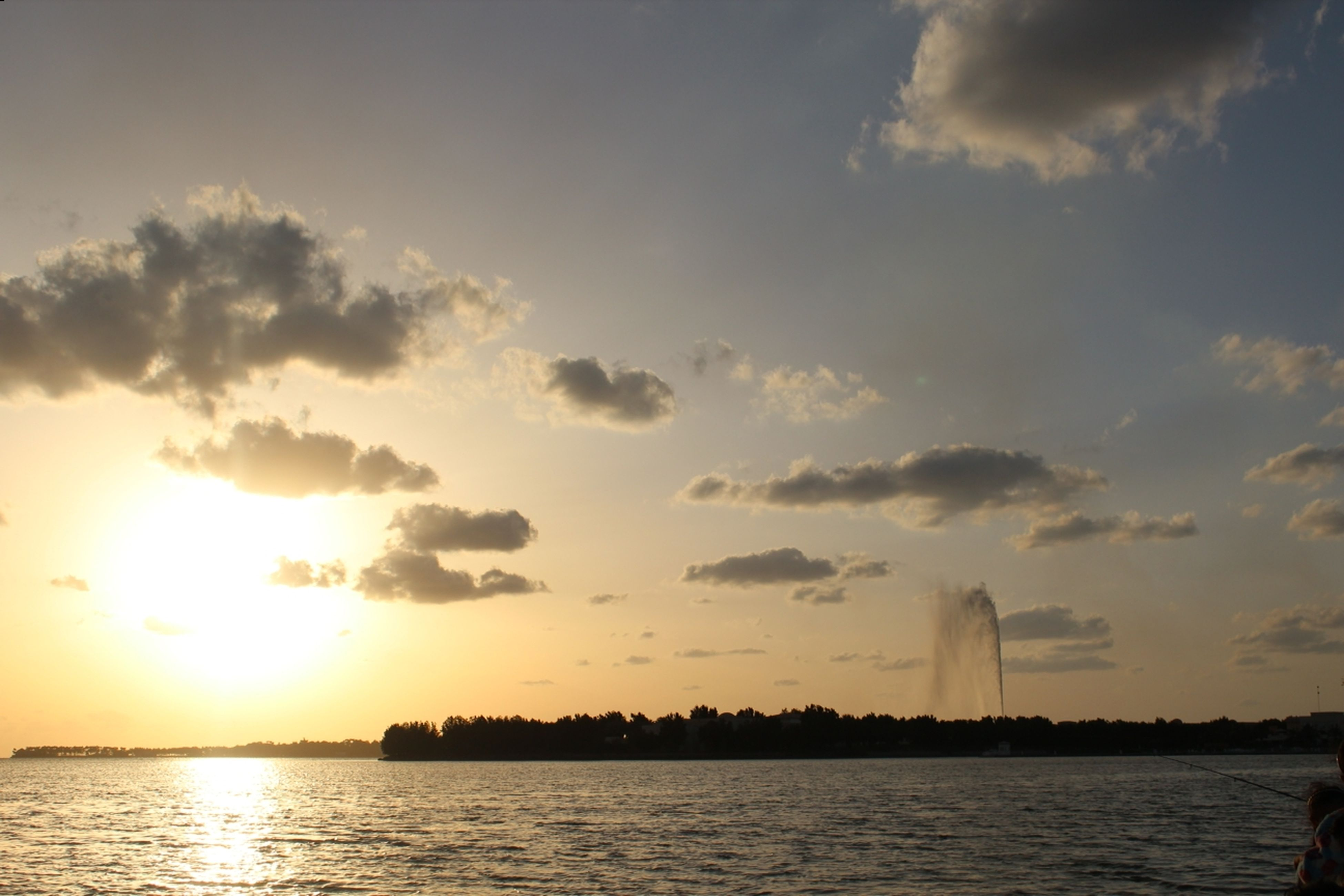 sunset, water, waterfront, sun, sea, sky, scenics, beauty in nature, sunlight, building exterior, built structure, architecture, reflection, sunbeam, nature, orange color, tranquil scene, tranquility, silhouette, idyllic