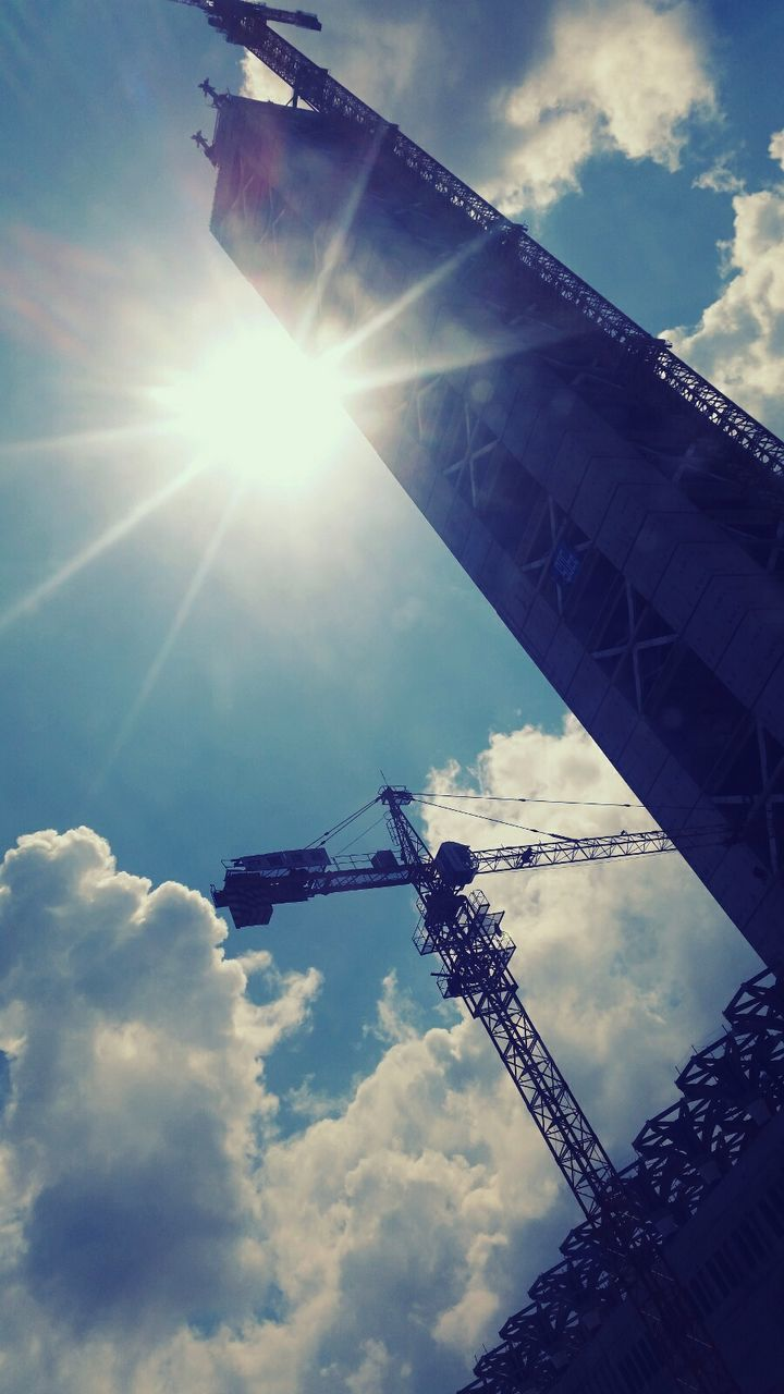 sky, sunlight, sunbeam, low angle view, sun, lens flare, cloud - sky, outdoors, day, built structure, no people, nature, architecture