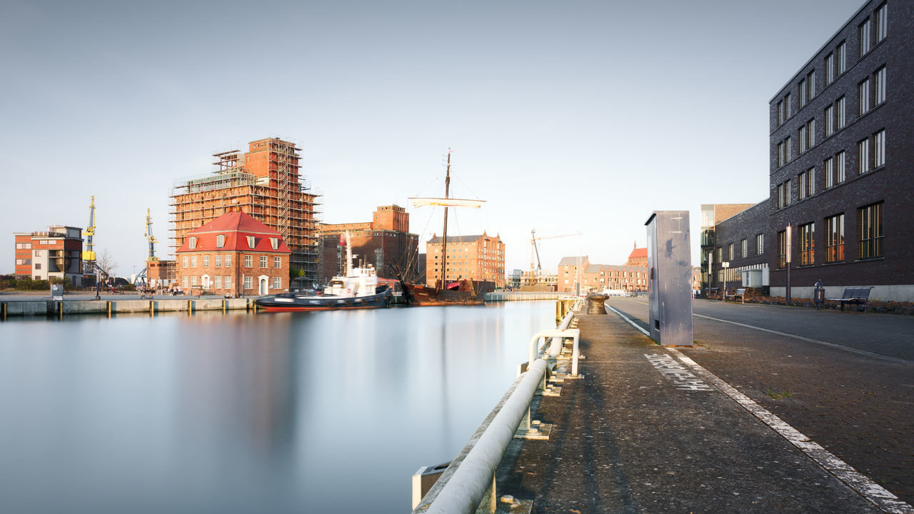 commercial dock by sea against clear sky Architecture Building Exterior Built Structure City Cityscape Clear Sky Day Fine Art Long Exposure Mecklenburg-Vorpommern Modern Muted Colors Nautical Vessel No People Outdoors River Sky Skyscraper Travel Travel Destinations Urban Skyline Water Waterfront Wismar Wismarhafen