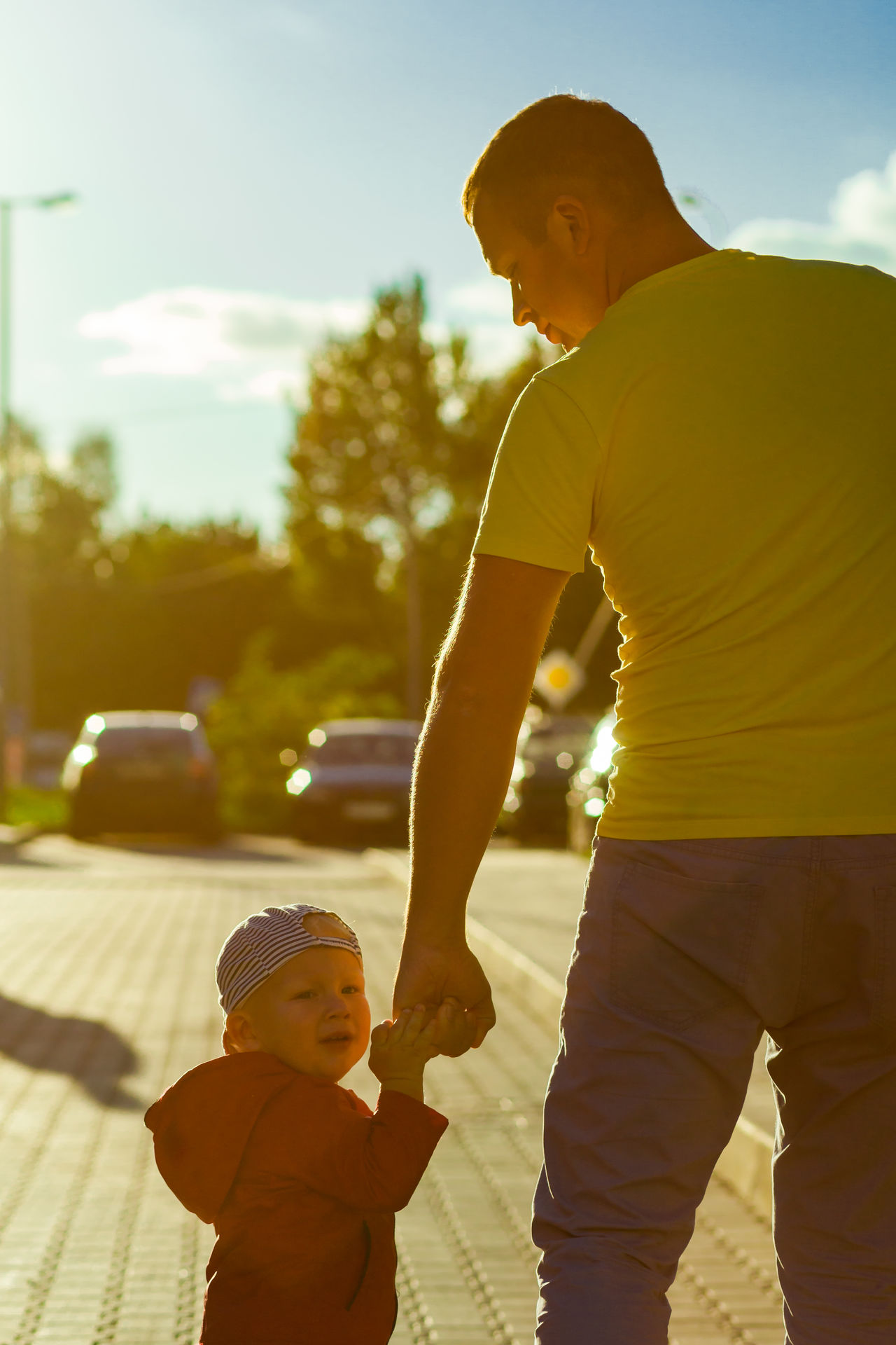 Father and son on a walk Parent Adult Cheerful Child Childhood Day Embracing Father, Females Happiness Happy Human Body Part Life Lifestyles Living Love Males  Men Outdoors People Sunlight Togetherness Two Two People Vertical