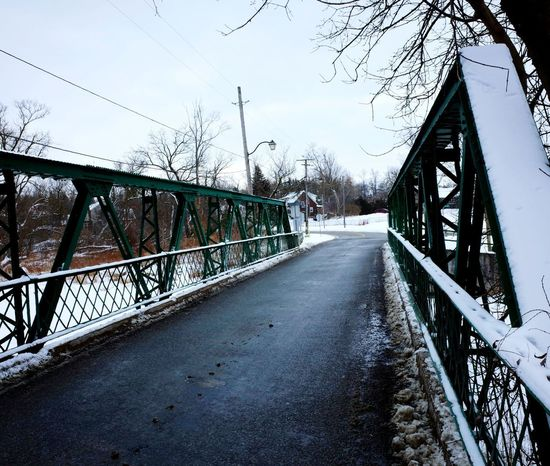 This old bridge Bridge - Man Made Structure Graffiti Sky Winter Cold Temperature Built Structure The Way Forward Snow Transportation Day Outdoors Architecture No People Water Nature City