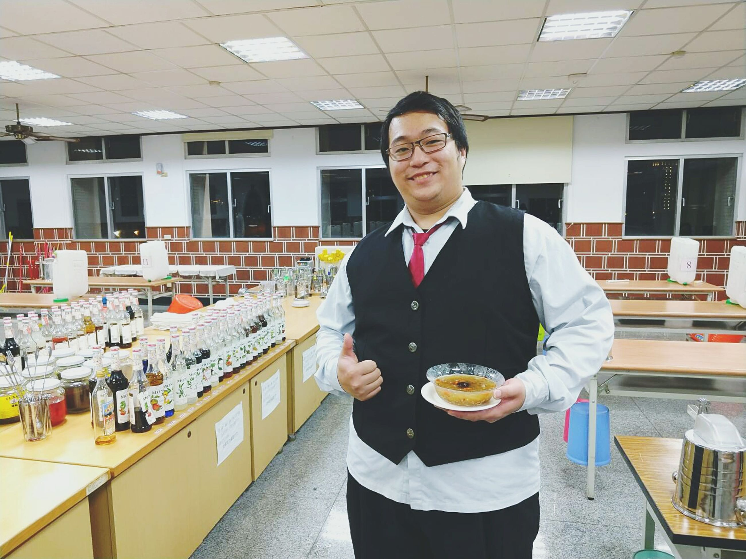 food and drink, one person, food, looking at camera, standing, holding, front view, real people, smiling, portrait, men, indoors, uniform, service, occupation, young adult, day, student, freshness, people