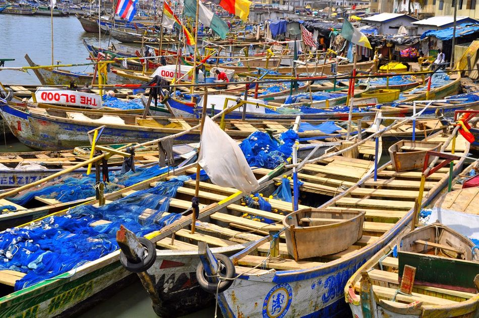Elmira Harbour Africa African Boat Fish Fisherman Fishing Fishing Boat Fishing Net Fishing Port Fishing Village Flag Flags In The Wind  Ghana Ghanaian Group Of Objects Harbor Harbour In A Row Multi Colored No People Poverty Tradition Traditional Water Wooden Boat