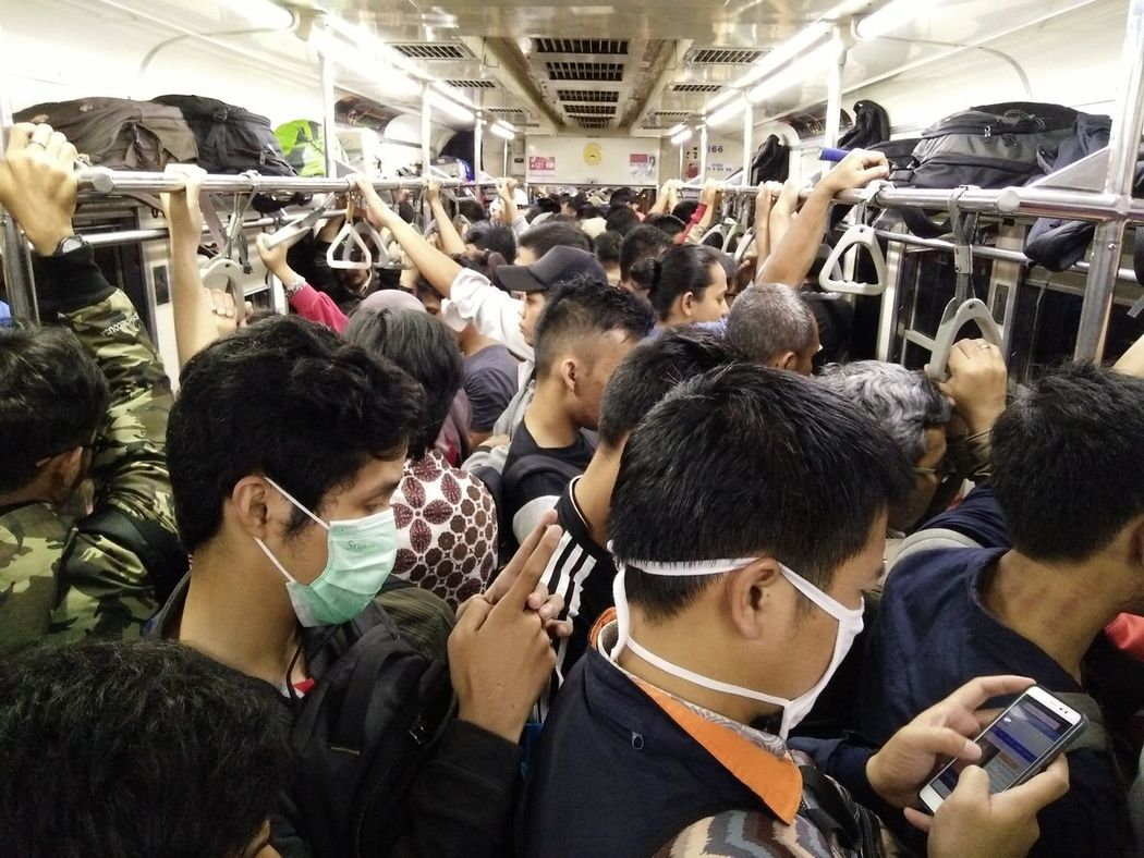 Inside a commuter train, people browsing internet in the middle of fully crowded train After Office Hours Commuter Train Commuting Ride Crowded Metro Crowded Train Night Public Transportation Tough Life Train