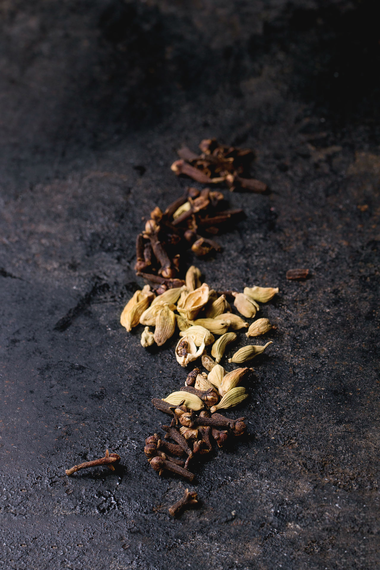 Cardamom seeds and cloves over black background Aromatic Black Background Cardamom Cloves Cooking Food Food Background Food Photography Healthy Eating High Angle View Indian Spices Ingredient Seasoning Seeds Space For Text Spice Spicy Various