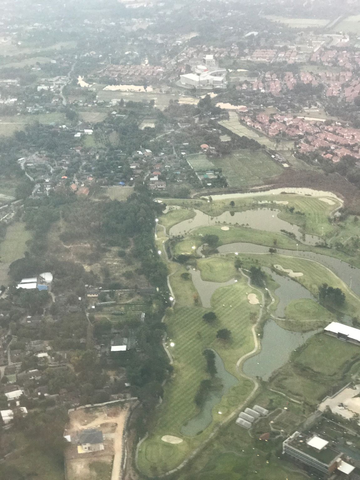 View From Above High Angle View Aerial View Agriculture Landscape City Patchwork Landscape Field Building Exterior Green Color Rural Scene Outdoors Day No People Built Structure Nature Beauty In Nature Goftam Green Grass Golf Club Sankampaeng Grass Field Landscape_Collection Landscapes Flying High