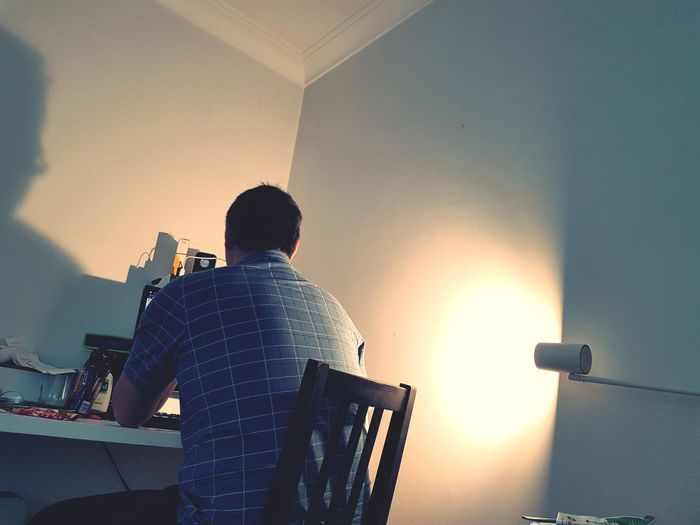 Work from Home with the hubby. Rear View One Man Only Lifestyles Technology Indoors  Life Photooftheday Reflection Gloomy Weather Rainy Refelections Of A Man