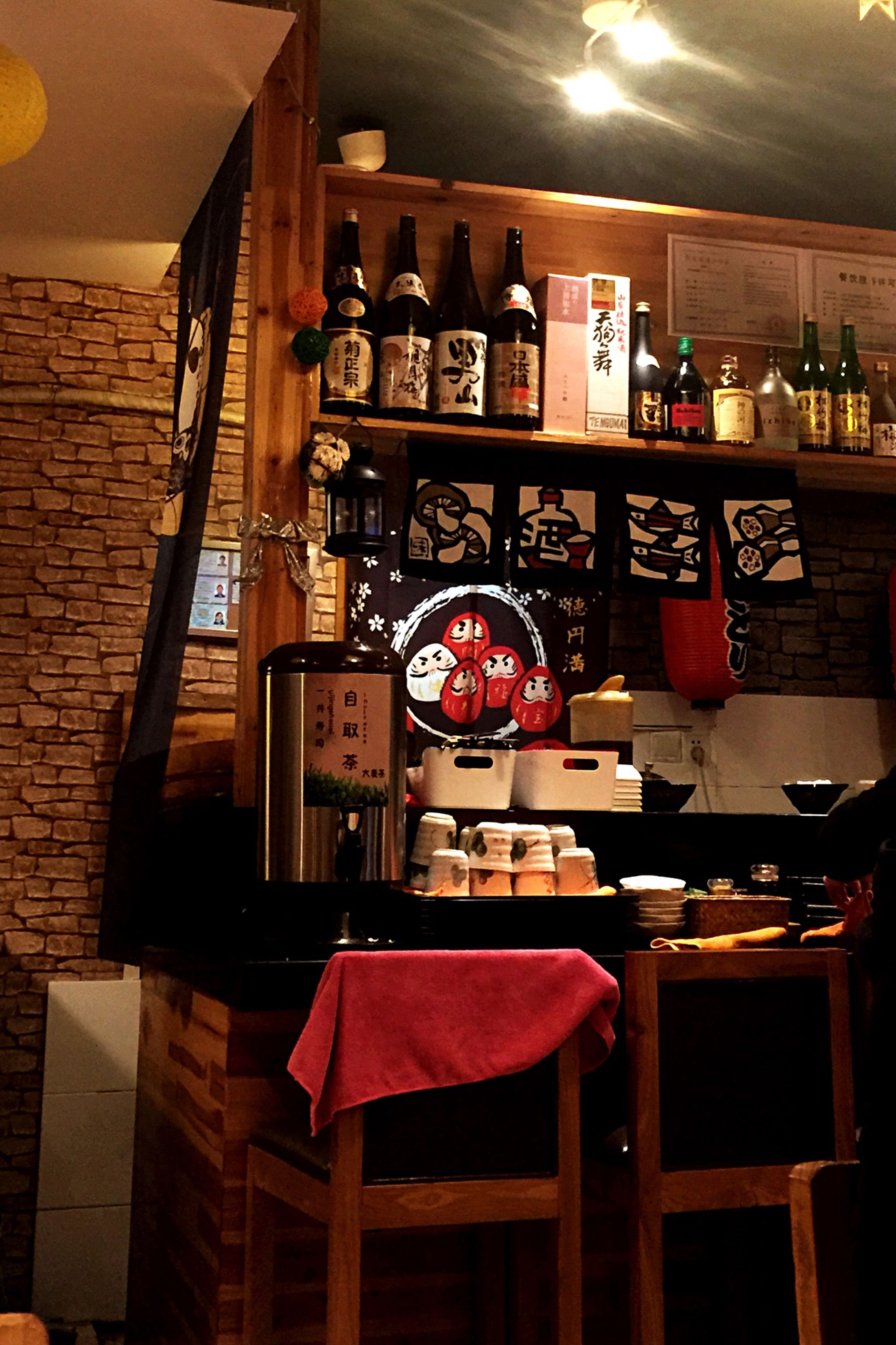 indoors, table, chair, architecture, built structure, restaurant, absence, illuminated, window, home interior, hanging, house, no people, red, lighting equipment, still life, electric lamp, wood - material, shelf, building exterior