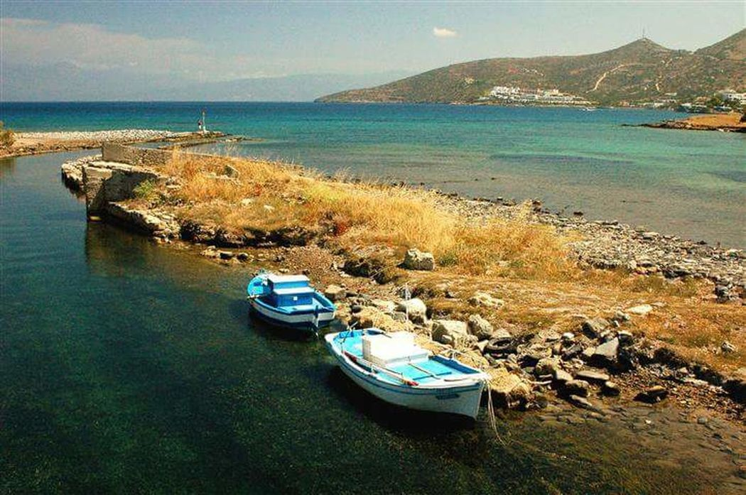 Water Nautical Vessel Sea Transportation Boat Tranquil Scene Mountain Mode Of Transport Tranquility Scenics Beach Nature Blue Beauty In Nature Sky Non-urban Scene Coastline Calm Shore Day Elounda Greek Islands Crete Crete Greece Greece
