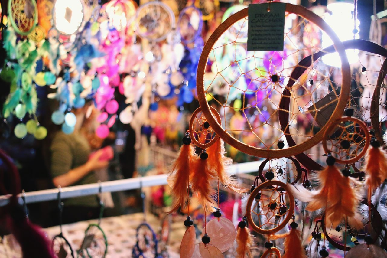 Illuminated Retail  Hanging Night Store For Sale Arts Culture And Entertainment Multi Colored Luck No People Business Close-up Outdoors Chaingmaithailand Night Market In Thailand BELEIVE Amulet Indain Style Dream Catcher Full Frame Hanging Travel Destinations Barrette Day Chaing Mai, Thailand