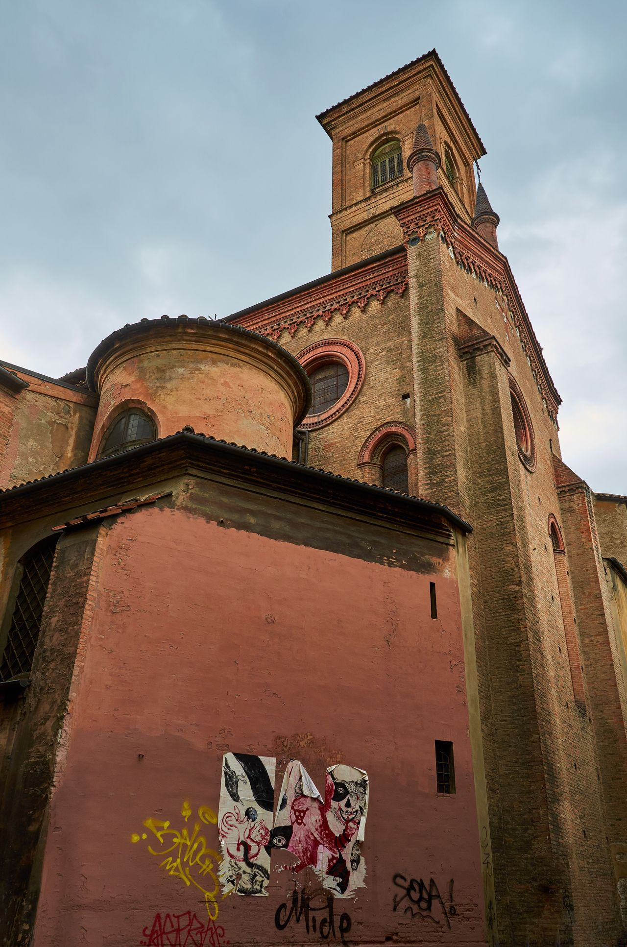 Bologna, Italy Bologna Italy Textures And Surfaces Cloud - Sky Urban Building Building Exterior Architecture Historic Historical Building Lookingup Built Structure Low Angle View No People Church Bell Tower Cupola Graffiti Street Art Place Of Worship Religion Round Window Brick