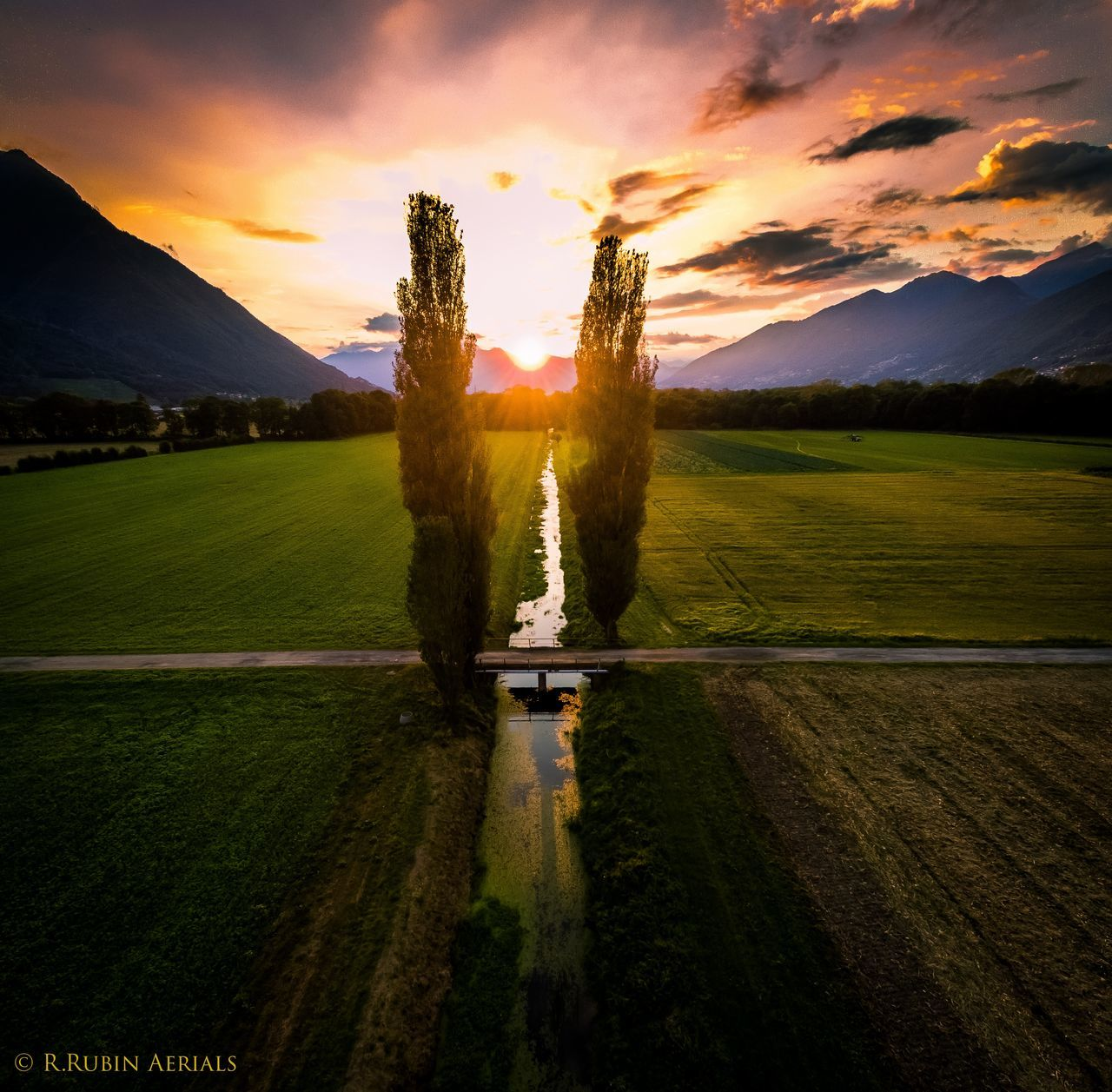 Mountain Landscape Scenics Tranquility Sun Agriculture Tranquil Scene Green Color Sky Field Nature Non-urban Scene Outdoors Cloud - Sky Beauty In Nature Sunbeam Motion Spraying Mountain Range Splashing Aerial View Aerial Photography Dronepointofview Dronephotography